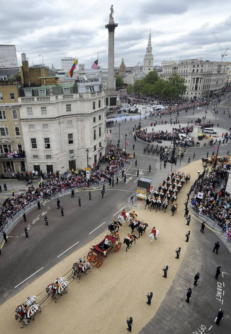 LONDON, UNITED KINGDOM - JUNE 05:  Queen Elizabeth II travels through Trafalgar Square by carriage with Prince Charles, Prince of Wales and Camilla, Duchess of Cornwall on the way to Buckingham Palace during the Diamond Jubilee celebrations on June 5, 2012 in London, England. For only the second time in its history the UK celebrates the Diamond Jubilee of a monarch. Her Majesty Queen Elizabeth II celebrates the 60th anniversary of her ascension to the throne today with a carriage procession and a service of thanksgiving at St Paul's Cathedral. (Photo by Anthony Devlin - WPA Pool/Getty Images)