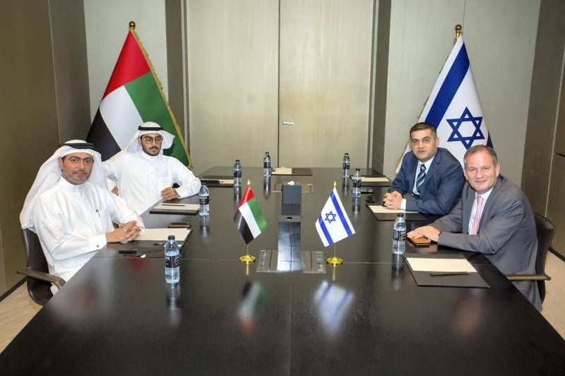 Emirati student Mansoor Al Marzooqi (seated behind left) with his father Mohamed Al Marzooqi across from Ilan Starosta, Israel consul general in Dubai, and Merzi Sodawaterwala, founder chairman of the International Federation of Indo-Israel Chambers of Commerce in Dubai. The meeting was held in Dubai on Sunday to congratulate and recognise Mansoor for becoming the first Emirati student in Israel. Courtesy: IFIICC