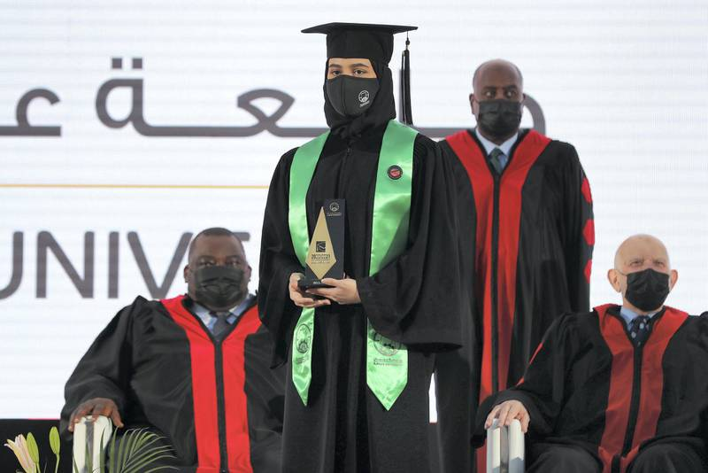 Ajman, United Arab Emirates - Reporter: Anam Rizvi. News. A student receives her award during her drive through graduation from Ajman University because of Covid-19. Wednesday, February 10th, 2021. Ajman. Chris Whiteoak / The National