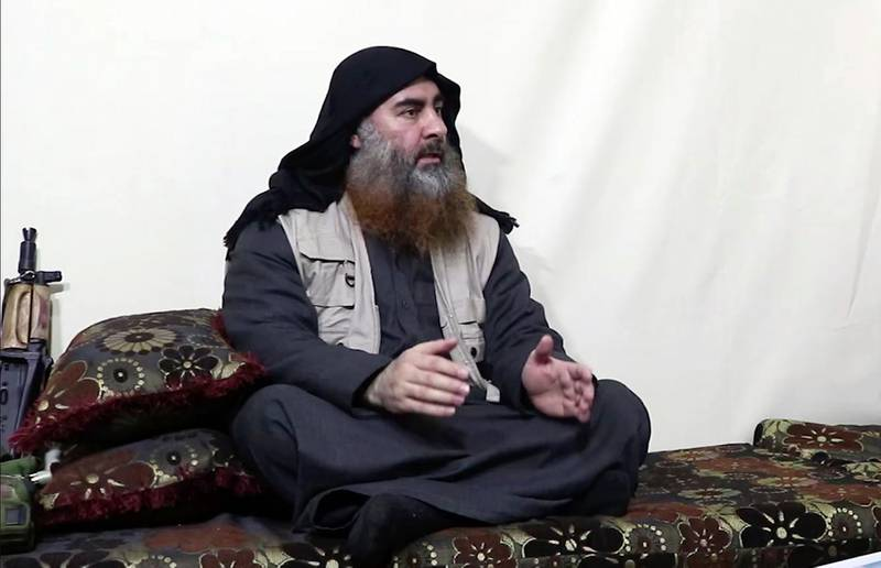 This image made from video posted on a militant website on Monday, April 29, 2019, purports to show the leader of the Islamic State group, Abu Bakr al-Baghdadi, being interviewed by his group's Al-Furqan media outlet. Al-Baghdadi acknowledged in his first video since June 2014 that IS lost the war in the eastern Syrian village of Baghouz that was captured last month by the Kurdish-led Syrian Democratic Forces. (Al-Furqan media via AP)