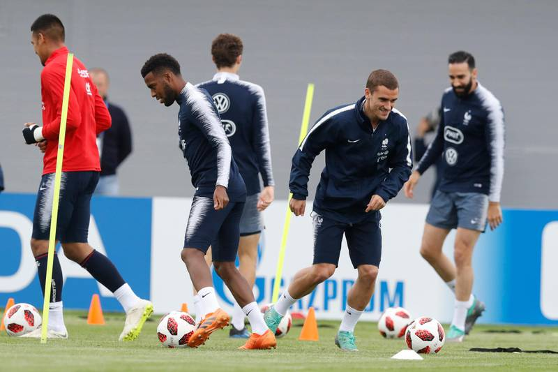 France's Antoine Griezmann smiles as he warms up during a training session at the 2018 soccer World Cup in Glebovets, Russia, Wednesday, July 4, 2018. (AP Photo/David Vincent)