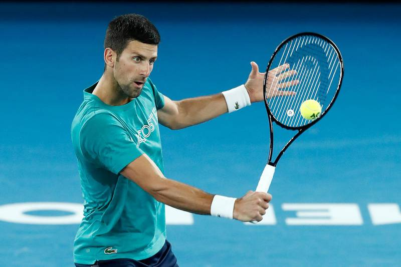 MELBOURNE, AUSTRALIA - FEBRUARY 20: Novak Djokovic of Serbia practices on Rod Laver Arena during day 13 of the 2021 Australian Open at Melbourne Park on February 20, 2021 in Melbourne, Australia. (Photo by Darrian Traynor/Getty Images)