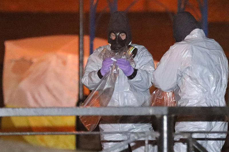 SALISBURY, ENGLAND - MARCH 13:  Police officers in forensics suits and protective masks work at the scene of the poisoning of Sergei Skripal on March 13, 2018 in Salisbury, England. British Prime Minister Theresa May has given the Russian government a deadline of midnight tonight to explain why a nerve agent of Russian origin was used in the poisoning of former Russian agent Sergei Skripal and his daughter. Mr Skripal who was granted refuge in the UK following a 'spy swap' between the US and Russia in 2010 and his daughter remain critically ill after being attacked with a nerve agent.  (Photo by Christopher Furlong/Getty Images)