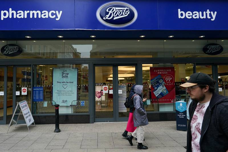 YORK, UNITED KINGDOM - JULY 09: Shoppers in York walk past a Boots pharmacy on July 09, 2020 in York, United Kingdom. Many UK businesses are announcing job losses due to the effects of the Coronavirus Pandemic and Lockdown. (Photo by Ian Forsyth/Getty Images)