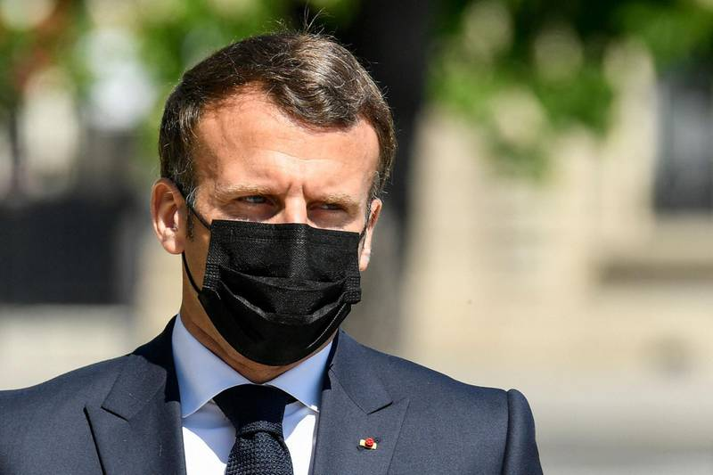 """French President Emmanuel Macron attends a ceremony marking the 106th anniversary of World War I-era mass killings of Armenians in Paris, on April 24, 2021. French President Emmanuel Macron went in front of an Armenian genocide memorial in the center of Paris, to """"participate in a moment of meditation"""", which in 2019 became National Day of Commemoration of the 1915 massacres. / AFP / POOL / Bertrand GUAY"""