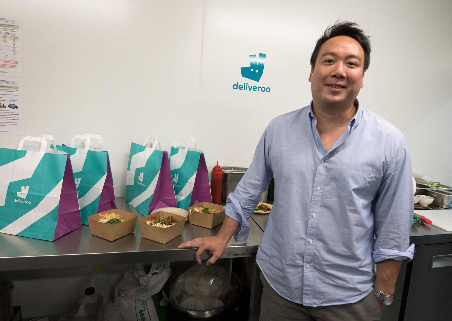 (FILES) In this file photo taken on July 03, 2018 co-founder and CEO of Deliveroo, Will Shu, poses during the launch of first kitchen Deliveroo Editions in Saint-Ouen, outside Paris. Takeaway meals app Deliveroo on March 4, 2021 said it had chosen London for its stock market listing, a major boost for the capital's financial sector which has been roiled by Brexit.    / AFP / GERARD JULIEN