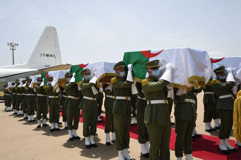 """A handout picture provided by the Algerian Presidency Press Service, shows the official ceremony for receiving the remains of 24 Algerian resistance fighters decapitated during the French colonial conquest of the North African country, each in a coffin draped with the national flag, following their arrival at Algiers airport on a flight from France on July 3, 2020. To a military guard of honour and with President Abdelmajid Tebboune at the scene, the remains were flown in to Algiers on a Hercules C-130 transport plane, accompanied by Algerian fighters. France's return of the remains this weekend. France's 132 years of colonial rule, and the brutal eight-year war that ended it, have left a lasting legacy of often prickly relations between the two governments and peoples.  - === RESTRICTED TO EDITORIAL USE - MANDATORY CREDIT """"AFP PHOTO / HO / ALGERIAN PRESIDENCY PRESS SERVICE """" - NO MARKETING NO ADVERTISING CAMPAIGNS - DISTRIBUTED AS A SERVICE TO CLIENTS ===  / AFP / Algerian Presidency Press Office / - / === RESTRICTED TO EDITORIAL USE - MANDATORY CREDIT """"AFP PHOTO / HO / ALGERIAN PRESIDENCY PRESS SERVICE """" - NO MARKETING NO ADVERTISING CAMPAIGNS - DISTRIBUTED AS A SERVICE TO CLIENTS ==="""