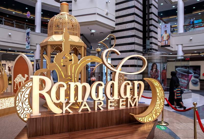 Abu Dhabi, United Arab Emirates, April 17, 2021.   Al Wahda Mall Ramadan decor.  Mall goers enjoy the Ramadan lanters exhibition at the main lobby of the mall.Victor Besa/The NationalSection:  NA/Stand Alone/Stock Images