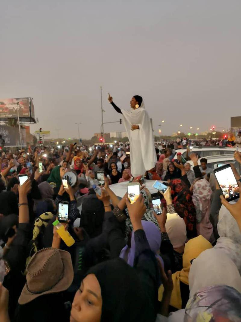 A Sudanese woman gestures during a protest demanding Sudanese President Omar Al-Bashir to step down along a bridge in Khartoum, Sudan April 8, 2019, in this still image taken from a social media video obtained on April 9, 2019. Courtesy Lana H. Haroun/via REUTERS ATTENTION EDITORS - THIS IMAGE HAS BEEN SUPPLIED BY A THIRD PARTY. MANDATORY CREDIT. NO RESALES. NO ARCHIVE