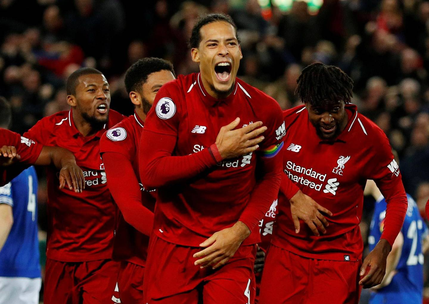 """FILE PHOTO: Soccer Football - Premier League - Liverpool v Everton - Anfield, Liverpool, Britain - December 2, 2018  Liverpool's Divock Origi celebrates scoring their first goal with Virgil van Dijk and team mates  REUTERS/Phil Noble  EDITORIAL USE ONLY. No use with unauthorized audio, video, data, fixture lists, club/league logos or """"live"""" services. Online in-match use limited to 75 images, no video emulation. No use in betting, games or single club/league/player publications.  Please contact your account representative for further details./File Photo"""