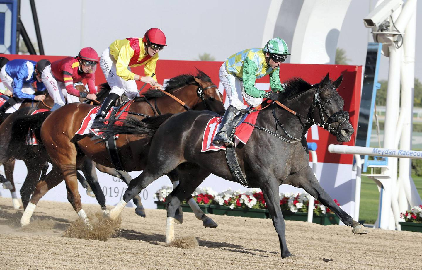 DUBAI , UNITED ARAB EMIRATES , Mar 7 – 2020 :- Tadhg O'Shea  (no 10) guides Wafy  (IRE)  to win the 2nd horse race Mahab Al Shimaal, 1200m Dirt during the Super Saturday meeting at the Meydan Racecourse in Dubai. Super Saturday is the dress rehearsal for the Dubai World Cup. ( Pawan Singh / The National ) For Sports. Story by Amith
