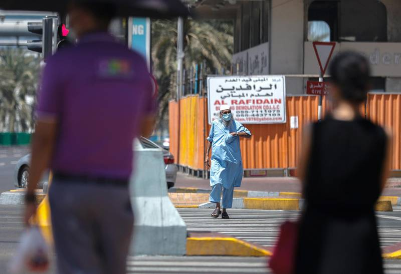 Abu Dhabi, United Arab Emirates, September 18, 2020.  Pedestrians cross the street at central Abu Dhabi on Friday afternoon.Victor Besa /The NationalSection:  NA/Standalone.