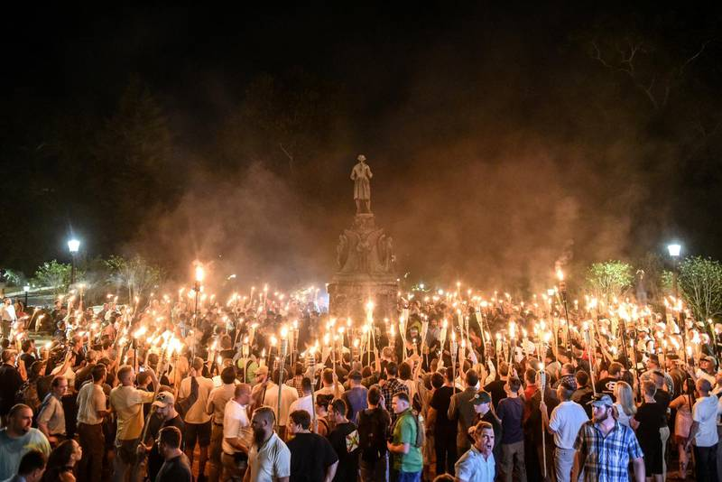 FILE PHOTO: FILE PHOTO: White nationalists participate in a torch-lit march on the grounds of the University of Virginia ahead of the Unite the Right Rally in Charlottesville, Virginia on August 11, 2017. Picture taken August 11, 2017.  REUTERS/Stephanie Keith/File Photo/File Photo