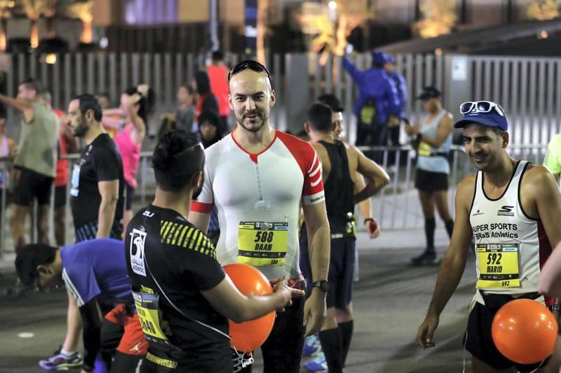 Abu Dhabi, United Arab Emirates - December 06, 2019: Athletes prepare for the ADNOC Abu Dhabi marathon 2019. Friday, December 6th, 2019. Abu Dhabi. Chris Whiteoak / The National