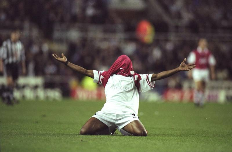 6 Dec 1997:  Ian Wright of Arsenal shows off the ''At Last'' written on his T-shirt after scoring the winning goal during an FA Carling Premiership match against Newcastle United at St James'' Park in Newcastle, England. Arsenal won the match 1-0. \ Mandatory Credit: Stu  Forster/Allsport / Getty Images
