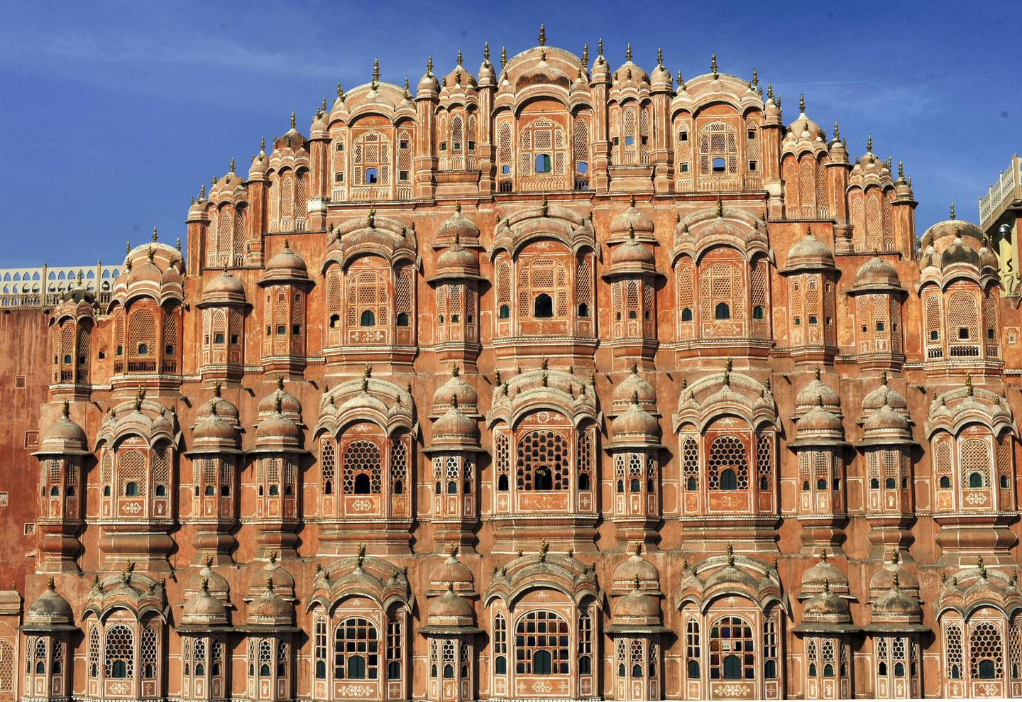 """The facade of the Hawa Mahal or """"Palace of Winds"""" in the old walled city of Jaipur on November 14, 2011.  The iconic building was designed to allow veiled ladies of the time to see the street scenes below without being seen. The baroque style building was built in 1799 by the Rajasthany royalty.  Jaipur is know as the """"Pink City"""" because its prominent buildings are washed in hue of pink.           AFP PHOTO/Roberto Schmidt (Photo by ROBERTO SCHMIDT / AFP)"""