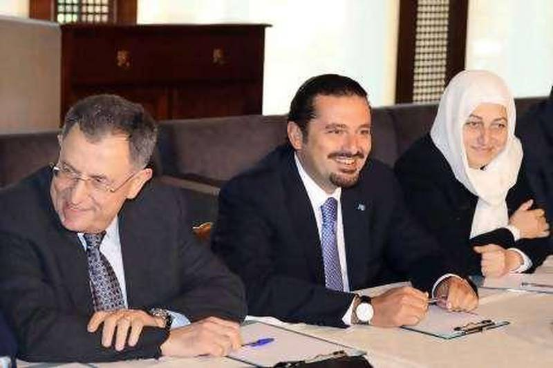 """A handout picture released by Dalati & Nohra show Lebanese Prime Minister Saad al-Hariri (C ), heading a meeting to """"the future"""" parliamentary block with former Prime Minister Fouad Siniora (L) and his aunt MP Bahia Hariri (R ) in his home, in Beirut, 20 September 2010, which offer """"to the overall political developments in the country."""" The PM returned from Saudi Arabia earlier on Monday and reportedly plans to attend Tuesday's cabinet session.  EPA/DALATI & NOHRA / HO  EDITORIAL USE ONLY"""