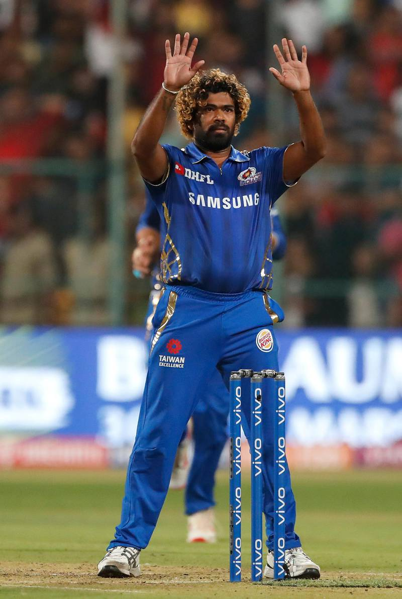 In this, Thursday, March 28, 2019 photo, Mumbai Indians' bowler Lasith Malinga gestures to his teammates after bowling the last delivery during the VIVO IPL T20 cricket match between Royal Challengers Bangalore and Mumbai Indians in Bangalore, India. Mumbai Indians won by six runs. (AP Photo/Aijaz Rahi)