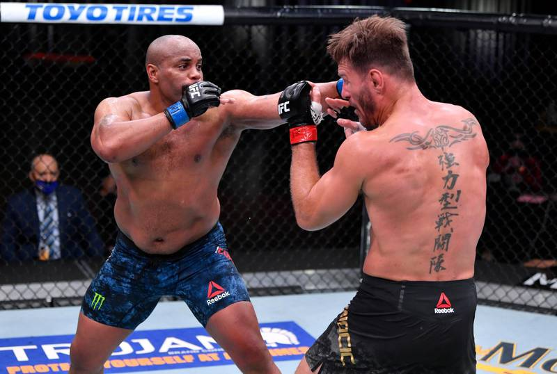 LAS VEGAS, NEVADA - AUGUST 15: (L-R) Daniel Cormier punches Stipe Miocic in their UFC heavyweight championship bout during the UFC 252 event at UFC APEX on August 15, 2020 in Las Vegas, Nevada. (Photo by Jeff Bottari/Zuffa LLC)