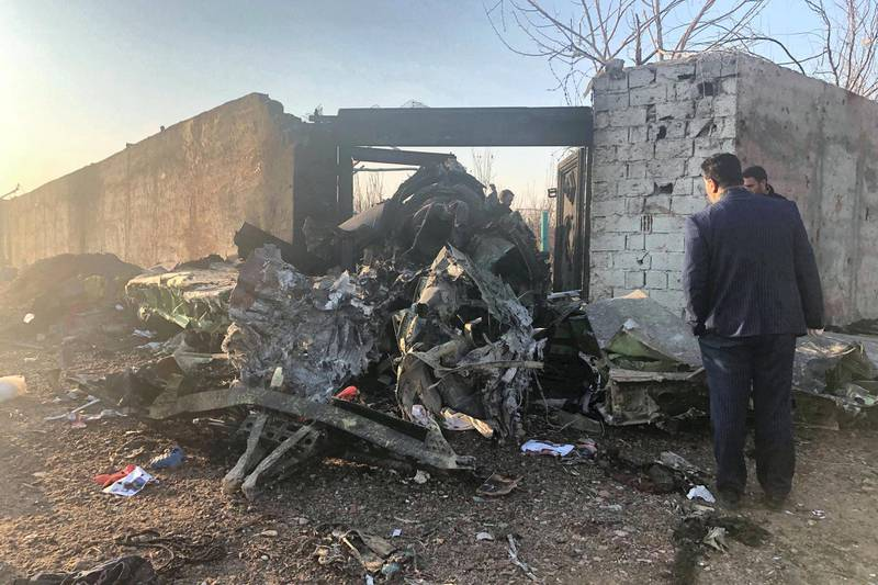 Debris is seen from a plane crash on the outskirts of Tehran, Iran, Wednesday, Jan. 8, 2019. A Ukrainian airplane carrying at least 170 people crashed on Wednesday shortly after takeoff from Tehran's main airport, killing all onboard, state TV reported. (AP Photos/Mohammad Nasiri)
