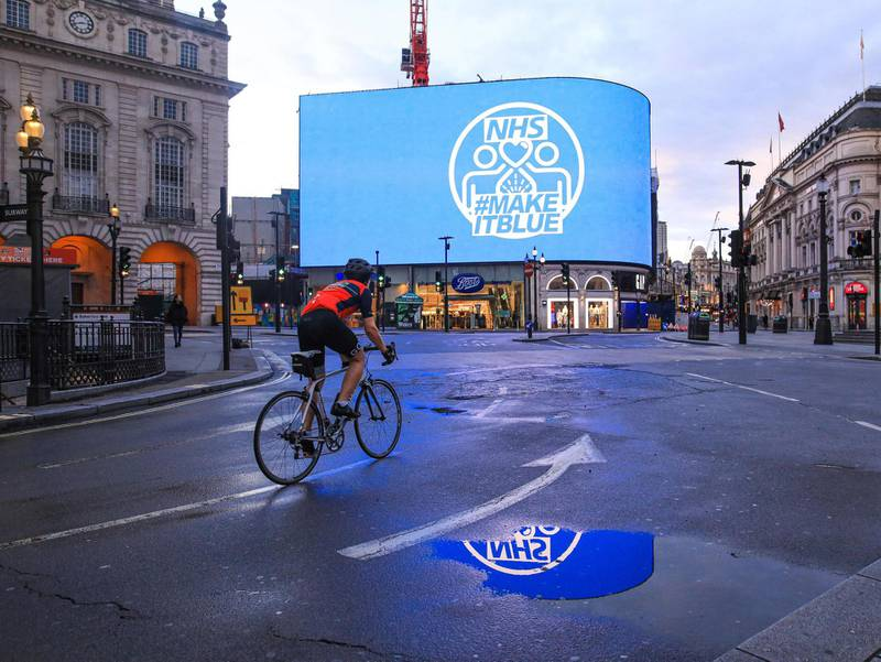 Light it BluePiccadilly Circus, Central LondonThursday 8 pm, lit up in blue for Thank you NHS. Cyclist on his one per day exercise. I am events and wedding photographer, based in central London, my job affected by pandemic totally. I always take my camera for my one per day walk. A captured moment of gratitude to our NHS. Photo by Alla Bogdanovic