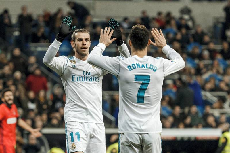 MADRID, SPAIN - FEBRUARY 10: Cristiano Ronaldo of Real Madrid celebrates after scoring a goal with Gareth Bale of Real Madrid during the La Liga match between Real Madrid and Real Sociedad at Estadio Santiago Bernabeu on February 10, 2018 in Madrid, Spain. (Photo by TF-Images/TF-Images via Getty Images)