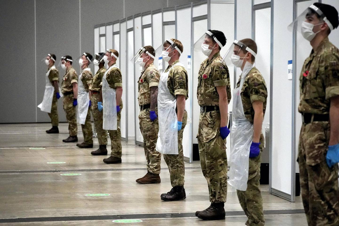 LIVERPOOL, ENGLAND - NOVEMBER 11: Soldiers from the Yorkshire Regiment observe a 2 minute silence to mark Remembrance Day at Liverpool Exhibition Centre, where the UK military are assisting with mass COVID-19 testing on November 11, 2020 in Liverpool, United Kingdom. Wednesday marked 102 years since the armistice that marked the end of World War I. (Photo by Christopher Furlong/Getty Images)