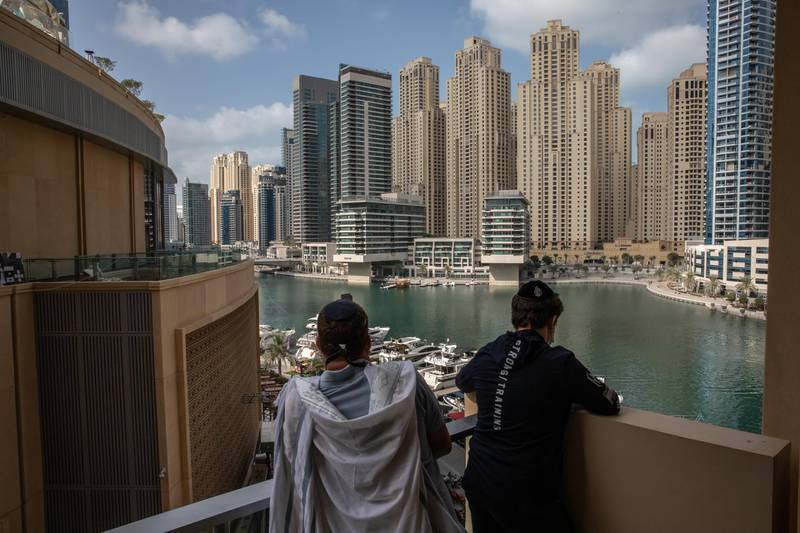 DUBAI, UNITED ARAB EMIRATES - FEBRUARY 26: Local Jewish residents and tourists pray during Purim at The Address Hotel Marina in Dubai on February 26, 2021 in Dubai, United Arab Emirates. The small but vibrant community has become more visible since the signing of the Abraham Accords, which normalized relations between the United Arab Emirates and Israel.  (Photo by Andrea DiCenzo/Getty Images)