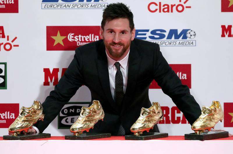 Barcelona's Lionel Messi poses with his four Golden Boot trophies during a ceremony in Barcelona, Spain, November 24, 2017.  REUTERS/Albert Gea     TPX IMAGES OF THE DAY