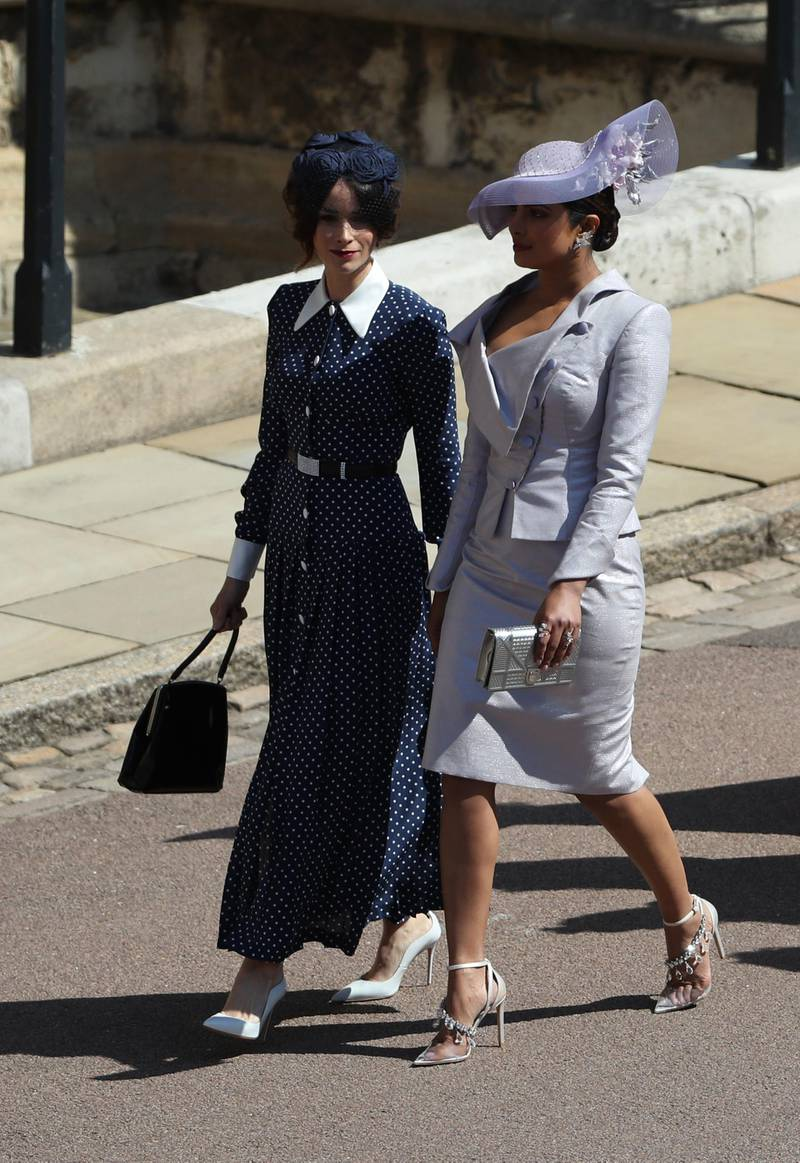 WINDSOR, UNITED KINGDOM - MAY 19:  Suits actress Abigail Leigh Spencer and Bollywood actress Priyanka Chopra (right) arrive for the wedding ceremony of Britain's Prince Harry and US actress Meghan Markle at St George's Chapel, Windsor Castle on May 19, 2018 in Windsor, England. (Photo by Andrew Milligan - WPA Pool/Getty Images)