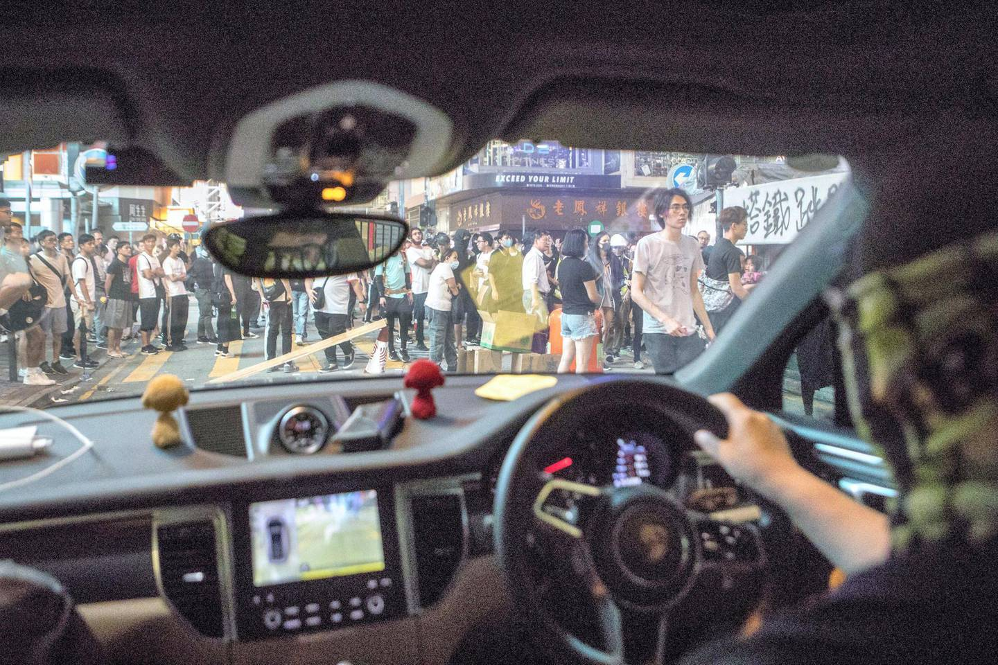 HONG KONG. SCHOOL BUS FEATURE: Chen makes his way through the crowds as he gives a volunteer medic a ride away from the protests safely to his home. 'School Buses', are the collective name to a group of volunteers, including Chen, who offer free transport for people who need help getting away from the protests safely.