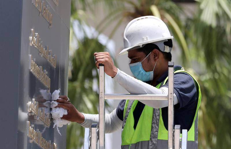 DUBAI, UNITED ARAB EMIRATES , June 11 – 2020 :- Worker wearing protective face mask during the hot and humid weather outside the Emirates NBD branch on Al Wasl road in Dubai. (Pawan Singh / The National) For News/Standalone/Online/Stock