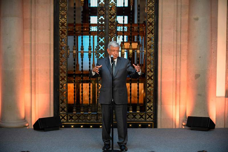 """Mexican President-elect Andres Manuel Lopez Obrador speaks during a press conference at the National Palace in Mexico City after holding a meeting with President Enrique Pena Nieto, on July 3, 2018 Mexican president-elect Andres Manuel Lopez Obrador meets his outgoing predecessor, Enrique Pena Nieto, to begin preparing the transition he promises will bring """"profound change"""" to the country. / AFP / ALFREDO ESTRELLA"""