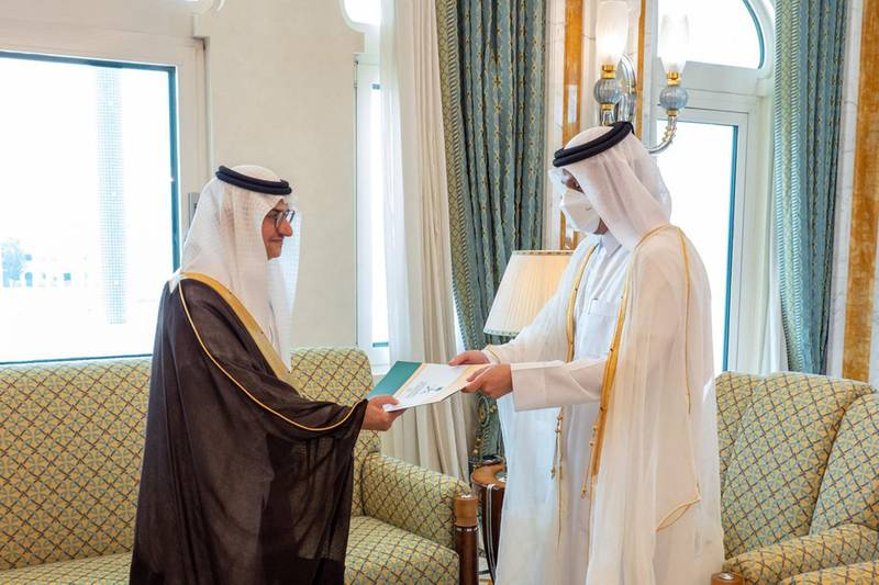 """A handout picture released by the Qatar News Agency (QNA) shows Qatari Deputy Prime Minister and Minister of Foreign Affairs Sheikh Mohammed Bin Abdulrahman Al-Thani(R) receiving a copy of the credentials of the Ambassador of the Kingdom of Saudi Arabia Prince Mansour bin Khalid bin Farhan Al-Saud, in Doha on June 21, 2021.  RESTRICTED TO EDITORIAL USE - MANDATORY CREDIT """"AFP PHOTO / QATAR NEWS AGENCY """" - NO MARKETING NO ADVERTISING CAMPAIGNS - DISTRIBUTED AS A SERVICE TO CLIENTS  / AFP / Qatar News Agency / - /  RESTRICTED TO EDITORIAL USE - MANDATORY CREDIT """"AFP PHOTO / QATAR NEWS AGENCY """" - NO MARKETING NO ADVERTISING CAMPAIGNS - DISTRIBUTED AS A SERVICE TO CLIENTS"""