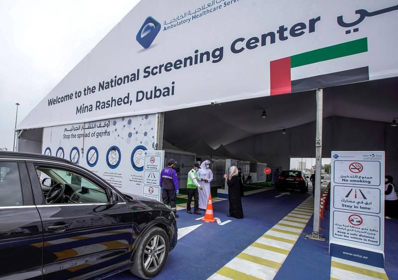 Dubai, United Arab Emirates, April 12, 2020.  Cars line up at the National Screening Center, Mina Rashed, Dubai.Victor Besa / The NationalSection:  NAReporter:  Nick Webster