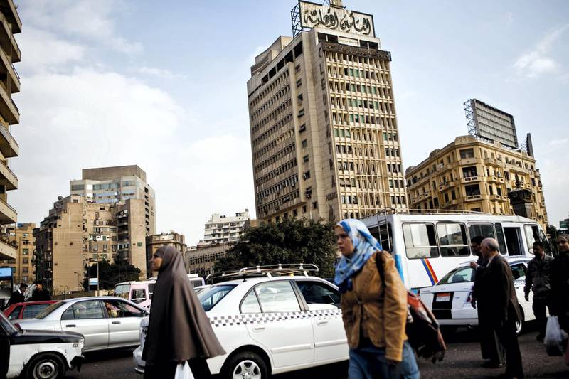 Pedestrians and traffic around Al Tahrir Square in Cairo, Egypt, December 29, 2009. (Photo by Ramin Talaie/Corbis via Getty Images)