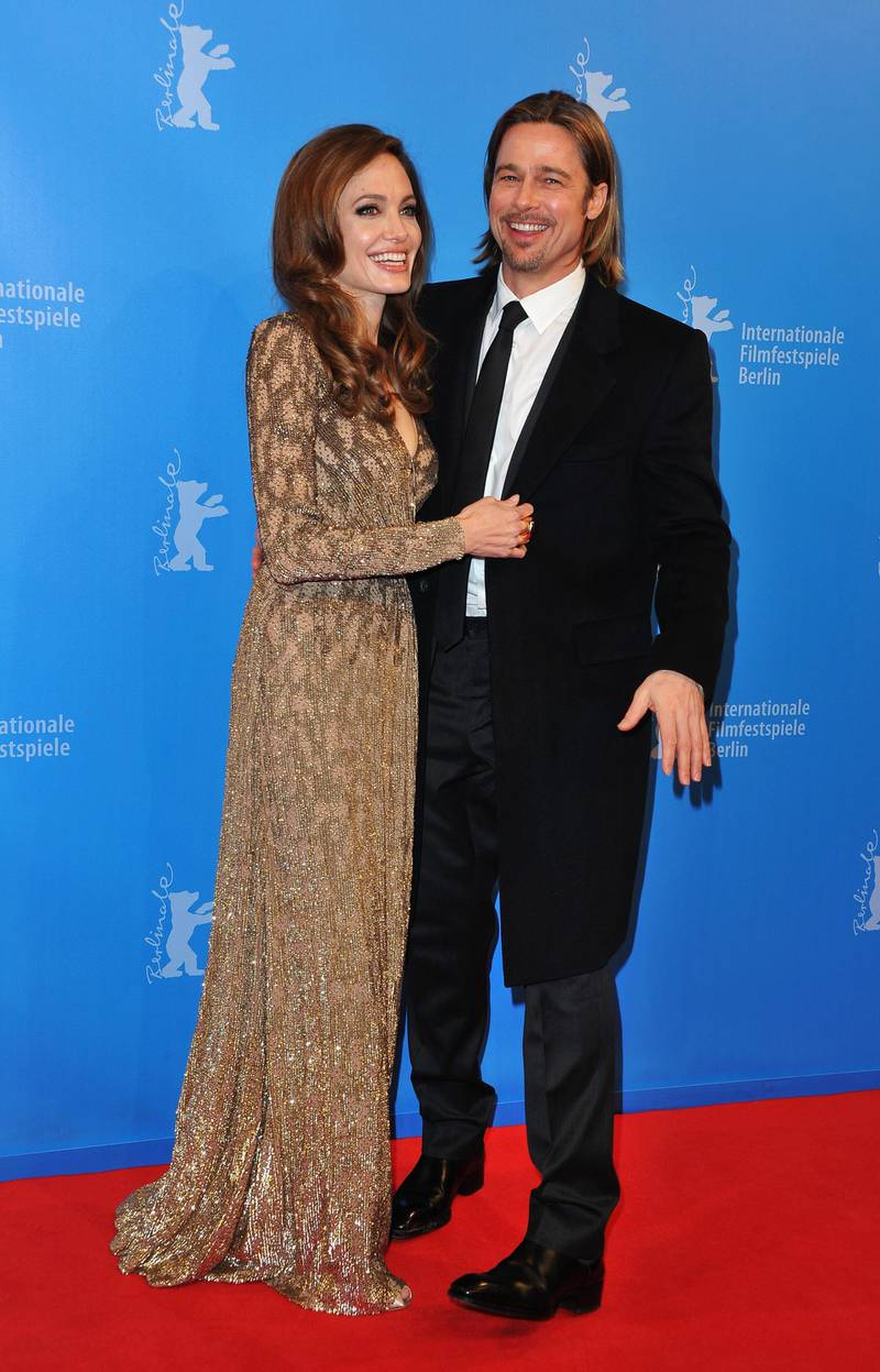 """BERLIN, GERMANY - FEBRUARY 11:  Brad Pitt and director Angelina Jolie attend the """"In The Land Of Blood And Honey"""" Premiere during day three of the 62nd Berlin International Film Festival at the Haus der Berliner Festspiele on February 11, 2012 in Berlin, Germany.  (Photo by Pascal Le Segretain/Getty Images)"""