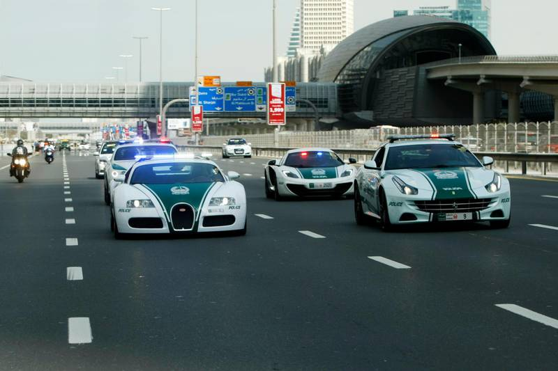Dubai, United Arab Emirates, February 8, 2014:      Police super cars drive ahead of cyclists during the fourth stage of the Dubai Tour cycling race in Dubai on February 8, 2014. Christopher Pike / The National  Reporter: Paul Radley Section: Sport