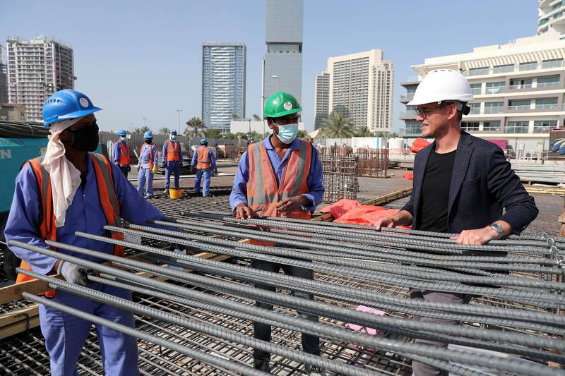 DUBAI, UNITED ARAB EMIRATES , Jan 31 – Bass Ackermann, owner (right) at the site of co-living apartment block at the Jumeirah Village Circle in Dubai. (Pawan Singh / The National) For News/Online. Story by Georgia Tolley