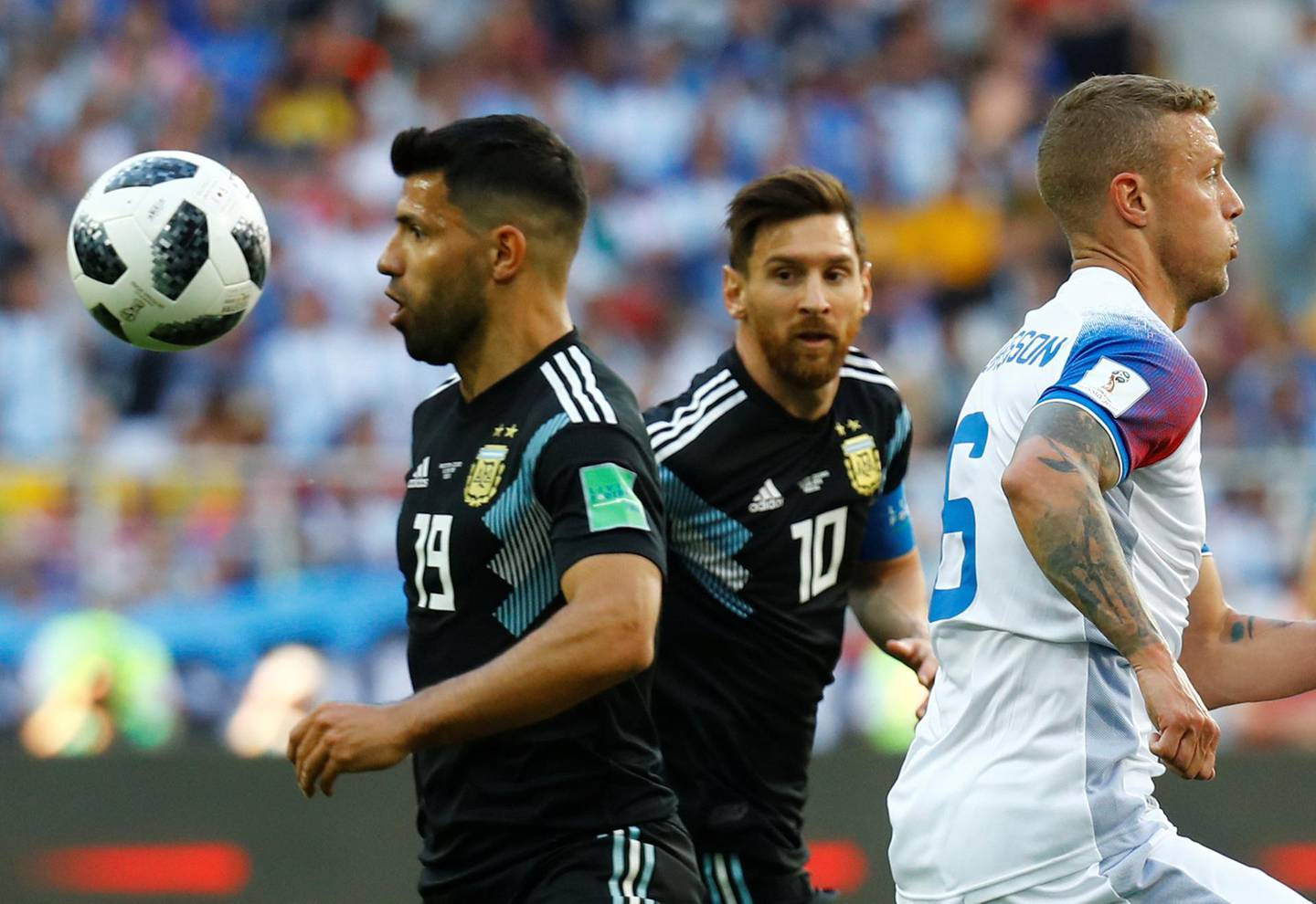 Soccer Football - World Cup - Group D - Argentina vs Iceland - Spartak Stadium, Moscow, Russia - June 16, 2018   Argentina's Sergio Aguero and Lionel Messi in action with Iceland's Ragnar Sigurdsson      REUTERS/Kai Pfaffenbach
