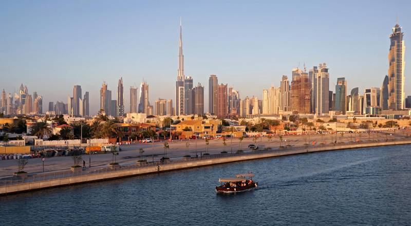 A picture taken on April 4, 2017, shows Dubai's skyline dominating the water canal, which links the city's business hub to the Gulf. (Photo by KARIM SAHIB / AFP)