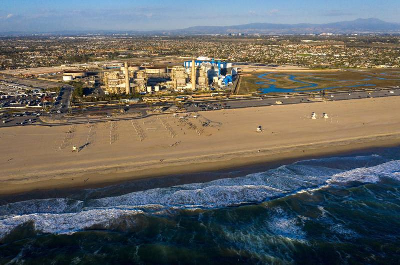 HUNTINGTON BEACH, CA - February 17: A view of the older AES Huntington Beach Power Station at left, and new one at right, and is the proposed site of the Poseidon Desalination Plant, which would draw ocean water through an existing intake pipe at Wednesday, Feb. 17, 2021 in Huntington Beach, CA. (Allen J. Schaben / Los Angeles Times via Getty Images)