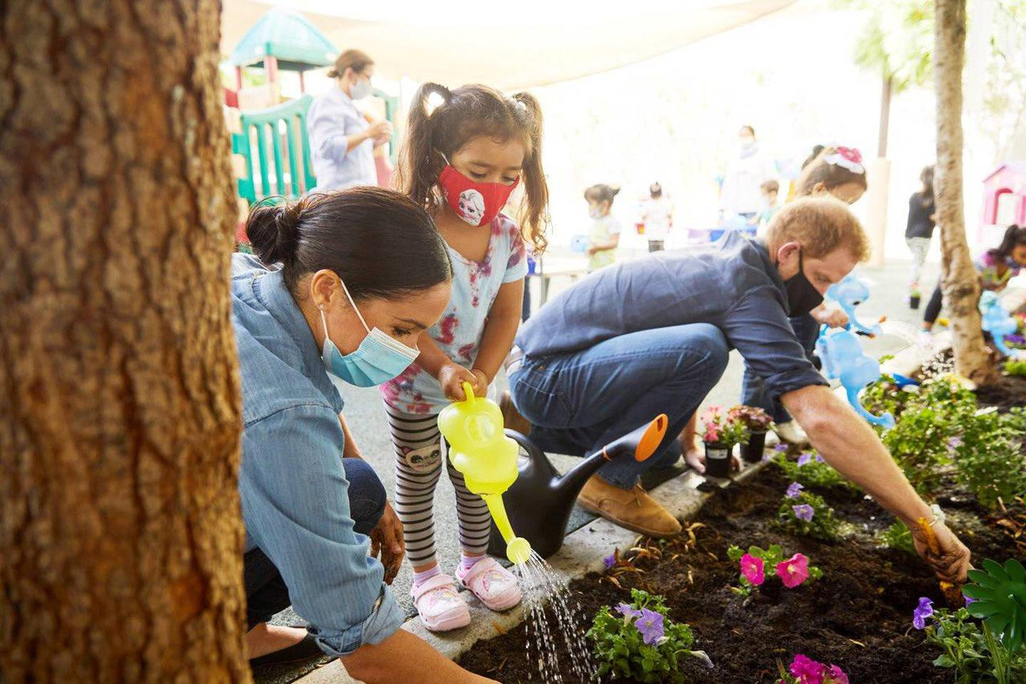 Prince Harry and Meghan Markle, the Duke and Duchess of Sussex, plant flowers and forget-me-nots during a visit to the Assistance League Los Angeles' Preschool Learning Center in Los Angeles, California, U.S. August 31, 2020, in this picture obtained from social media. Picture taken August 31, 2020. Mandatory credit MATT SAYLES/via REUTERS ATTENTION EDITORS - THIS IMAGE HAS BEEN SUPPLIED BY A THIRD PARTY. MANDATORY CREDIT. NO RESALES. NO ARCHIVES.