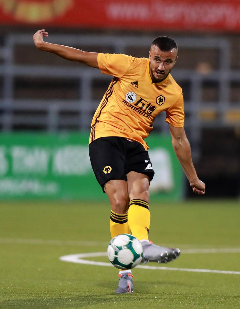 BELFAST, NORTHERN IRELAND - AUGUST 01:  Romain Saiss of Wolverhampton Wanderers passes the ball during the UEFA Europa League Second Qualifying round 2nd Leg match between Crusaders and Wolverhampton Wanderers at Seaview Stadium on August 01, 2019 in Belfast, Northern Ireland. (Photo by David Rogers/Getty Images)