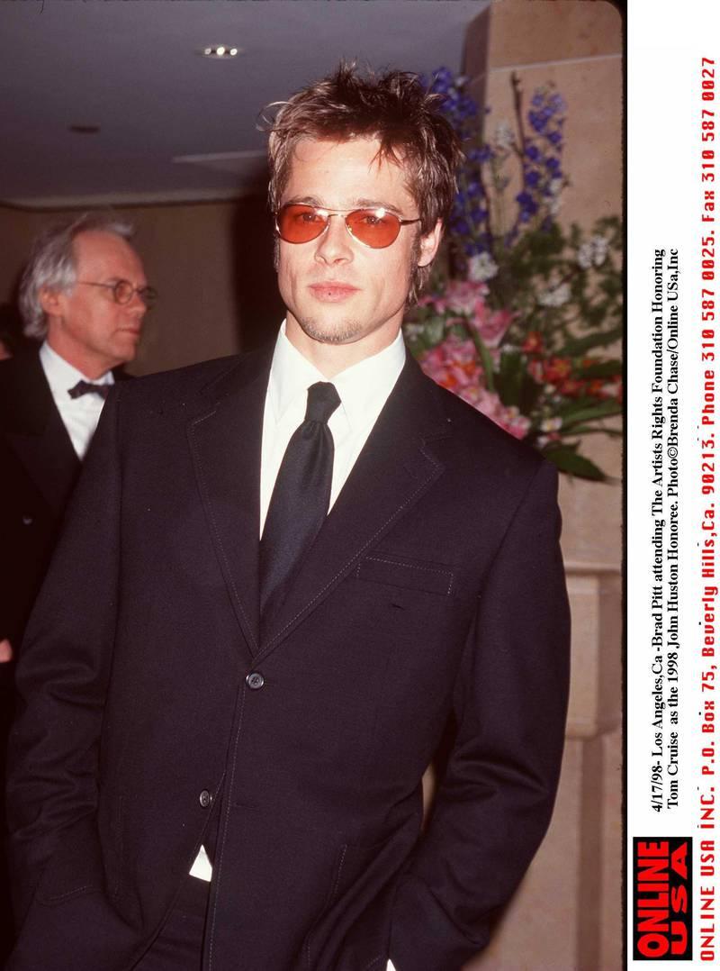 4/17/98- Brad Pitt attending the 1998 John Huston Award honoring Tom Cruise by the Artist Rights Foundation.