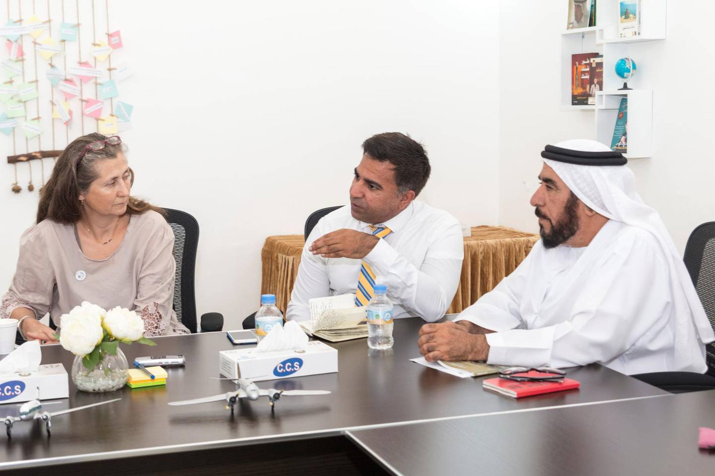 Sharjah, UAE - Mar 19, 2018 - Ms. Hazelle Page, Collections Manager for Sharjah Museums Authority, Mr. Ali Iqbal, a prominent historian, and Dr. Saif Al Bedwawi, military historian, discuss the wreckage from a World War II era crash site at the Al Mahatta Museum, Sharjah - Navin Khianey for The National