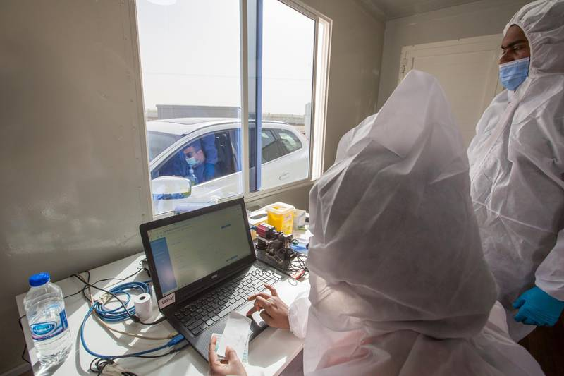 Dubai, United Arab Emirates - Medical staff processing the test at the new DPI Testing Centres border of Dubai and Abu Dhabi.  Leslie Pableo for The National for Shireena Al Nowais story