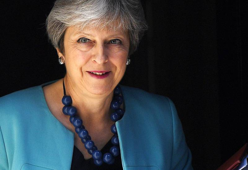 epa06843668 British Prime Minister Theresa May departs 10 Downing Street to attend the Prime Minister's Questions Time at the parliament in London, Britain, 27 June 2018.  EPA/ANDY RAIN