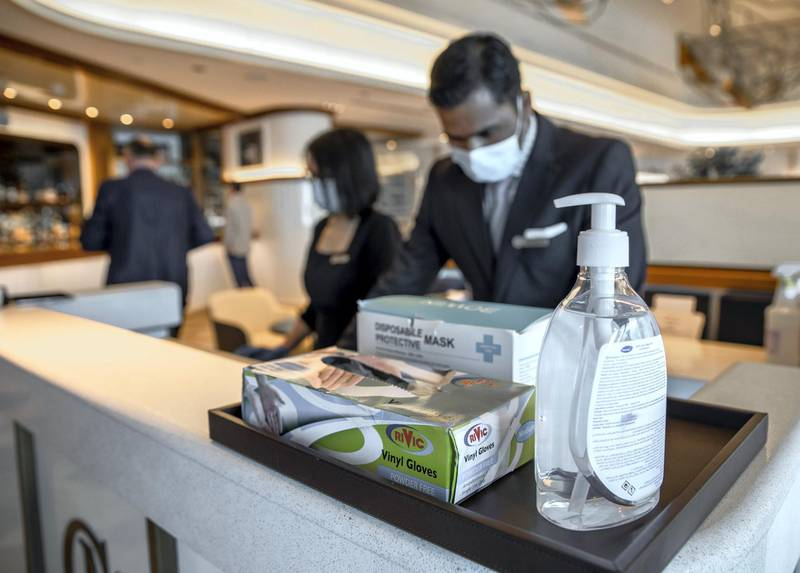 Abu Dhabi, United Arab Emirates, June 15, 2020.   Viny gloves, face masks and hand sanitiser at the reception of the Cafe Milano at the Four Seasons Hotel, Abu Dhabi.Victor Besa  / The NationalSection:  IfReporter:  Janice Rodrigues