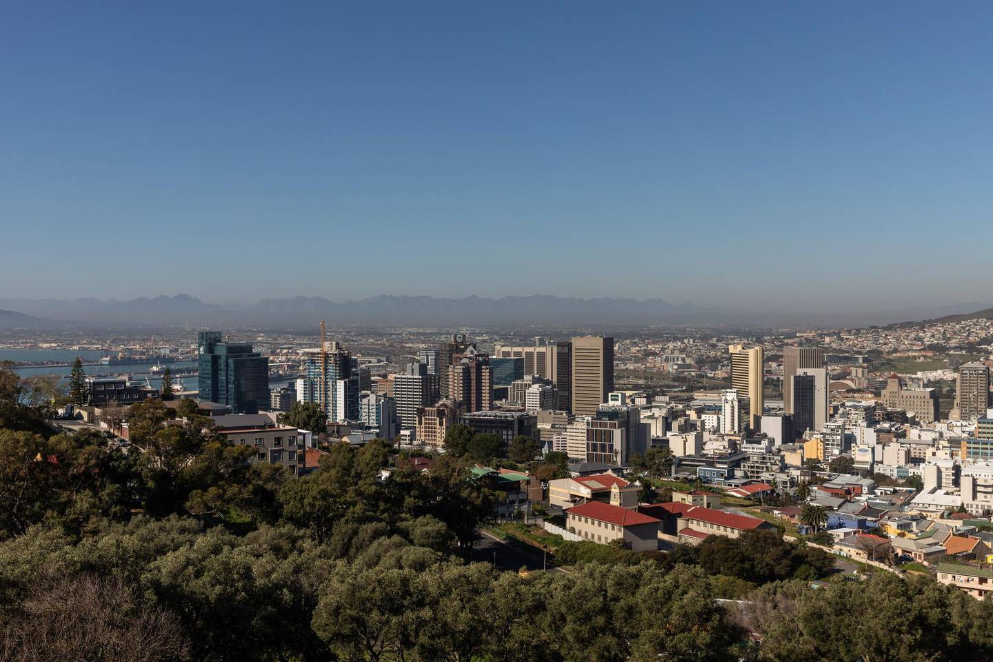 The port area stands beyond commercial high-rise properties in Cape Town, South Africa, on Thursday, July 23, 2020. South Africa's surging coronavirus infections and the resumption of rolling blackouts are clouding the outlook for the economy. Photographer: Dwayne Senior/Bloomberg
